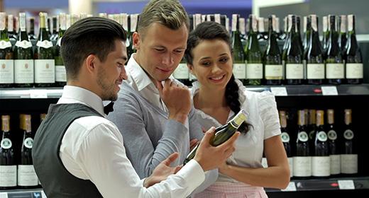 Сhoosing and buying wine in market
