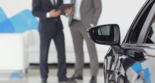 Man at a car dealership buying an auto