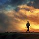 Man Walks On Horizon With Epic Cloudscape - VideoHive Item for Sale