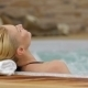 Back View Of a Woman Enjoying Jacuzzi - VideoHive Item for Sale
