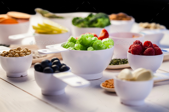 Portion cups of healthy ingredients on wooden table - Stock Photo - Images