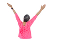 Rear view of mature woman with arms raised against white background