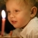 Little Boy Blowing Out Two Candles On His Birthday - VideoHive Item for Sale