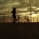 Girl On Bicycles At Sunset Sea - VideoHive Item for Sale