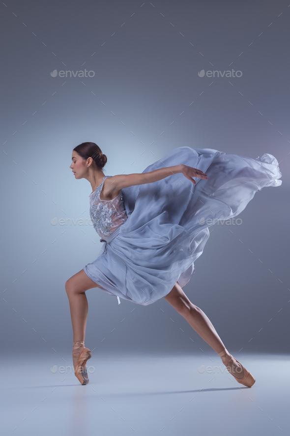 The beautiful ballerina dancing in blue long dress - Stock Photo - Images
