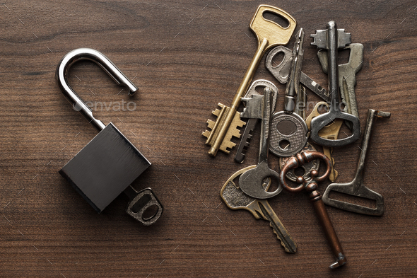 Opened Check-Lock And Different Keys Concept - Stock Photo - Images