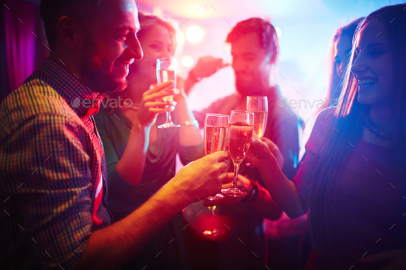 Toasting at party - Stock Photo - Images
