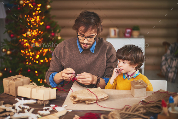 Preparing thread for tying gifts - Stock Photo - Images