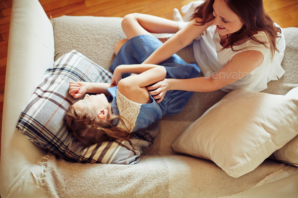 Playing on sofa - Stock Photo - Images