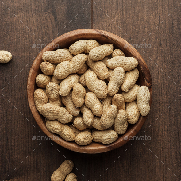 Peanuts In Wooden Bowl On The Table - Stock Photo - Images