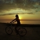 Girl On Bicycle At Sunset - VideoHive Item for Sale