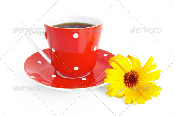Red coffee cup with a yellow flower - Stock Photo - Images