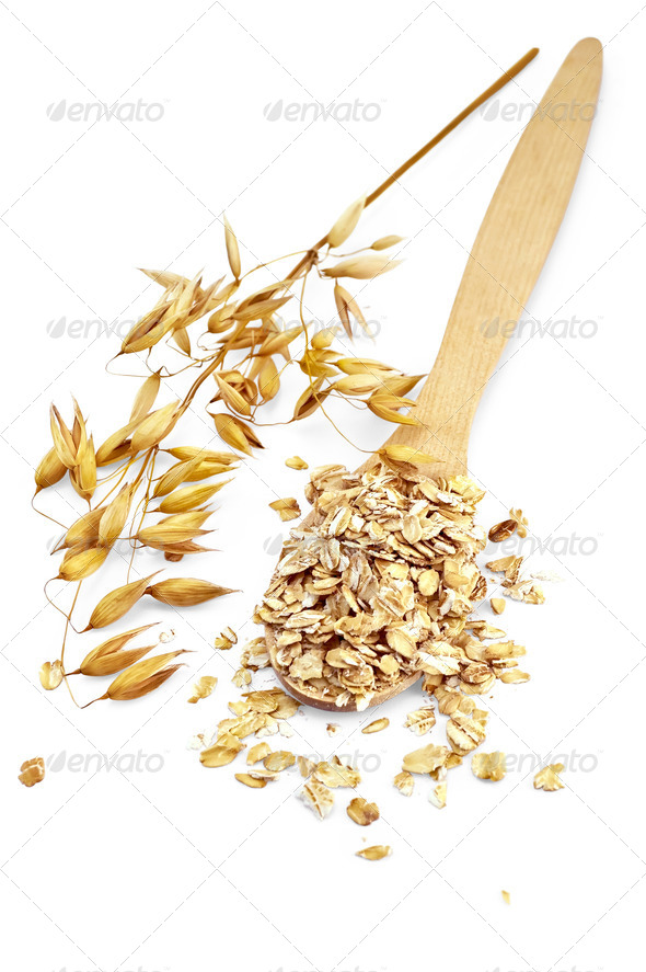 Rolled oats in a spoon - Stock Photo - Images