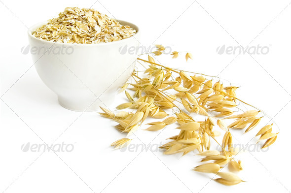 Rolled oats in a teacup - Stock Photo - Images