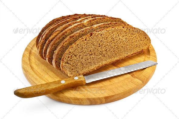 Rye bread on a round board with a knife - Stock Photo - Images