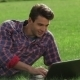 Man Lying On Grass At Park With Laptop - VideoHive Item for Sale