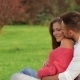 Couple Sitting On The Grass - VideoHive Item for Sale