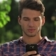 A Man Uses His Smart Phone - VideoHive Item for Sale