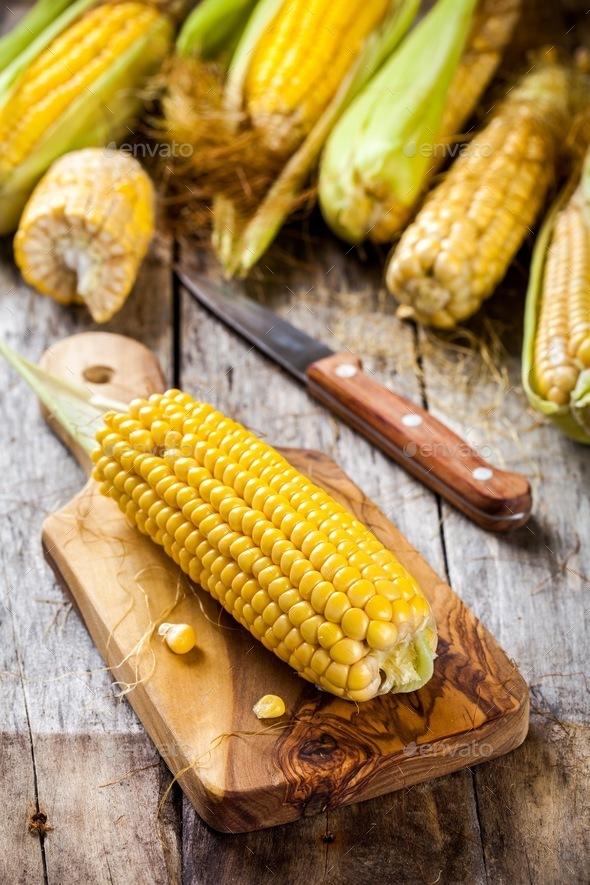 organic sweet corn on cutting board - Stock Photo - Images