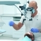 Dentist Using a Dental Microscope - VideoHive Item for Sale