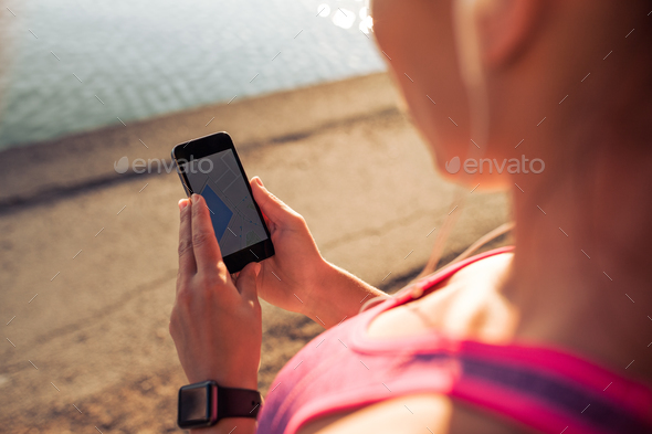 Sports woman using smart phone - Stock Photo - Images