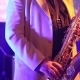 The Man In The White Suit Playing The Saxophone - VideoHive Item for Sale