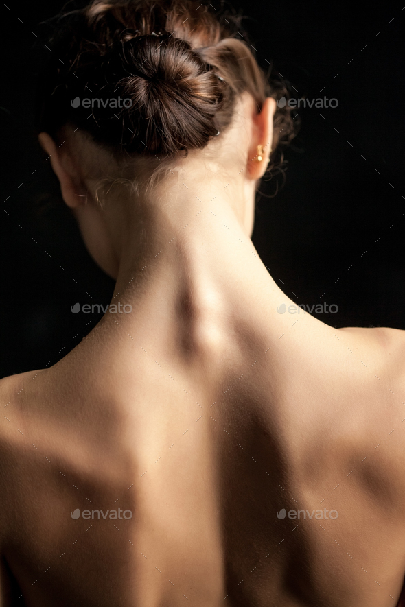 Beautiful woman, back view on dack background - Stock Photo - Images