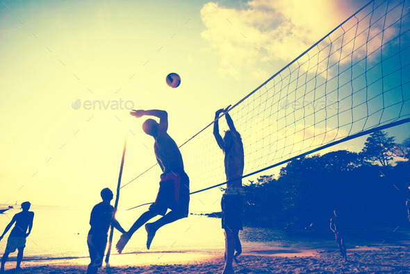 Beach Volleyball at Sunset Enjoyment Concept - Stock Photo - Images