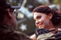 Bride embracing with groom in army suit