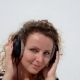 Happy Woman With Headphones Listening To Music - VideoHive Item for Sale