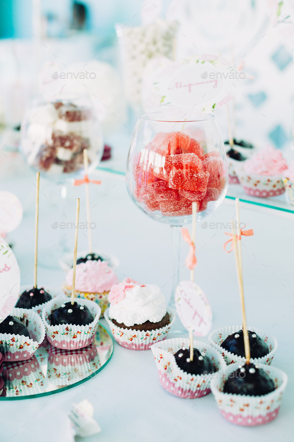 Various Dessert Sweet Cupcakes, Candy, confection On Table. Cand - Stock Photo - Images