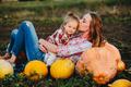 mother and daughter lie between pumpkins - PhotoDune Item for Sale