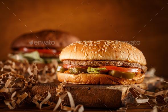 Burger on wood background - Stock Photo - Images