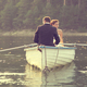 Beautiful bride and groom in a boat on the lake - PhotoDune Item for Sale