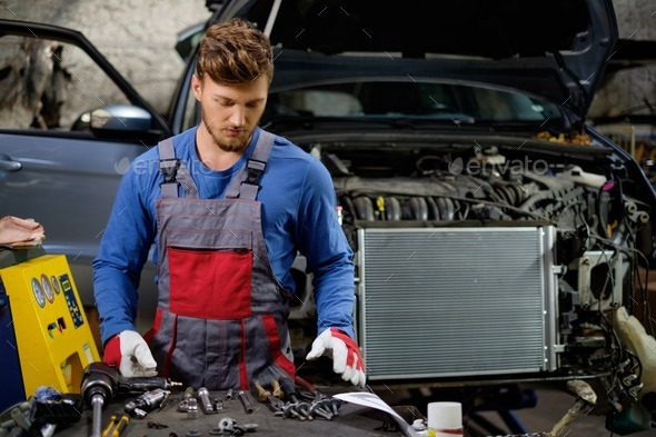 Mechanic in a workshop - Stock Photo - Images