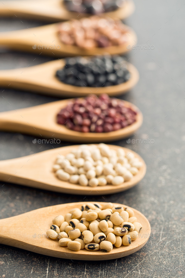 various legumes in wooden spoons - Stock Photo - Images