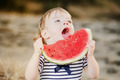 Cute girl kid at countryside eating big watermelon. - PhotoDune Item for Sale