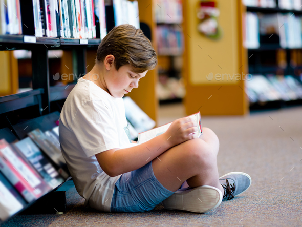 Boy in library - Stock Photo - Images