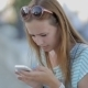 Girl Seriously Using a Smart Phone In a City - VideoHive Item for Sale