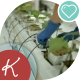 Woman In Gloves To Care For Plants In a Greenhouse - VideoHive Item for Sale