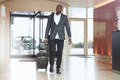 African businessman walking in hotel lobby - PhotoDune Item for Sale