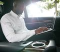 African businessman working on laptop inside a car - PhotoDune Item for Sale