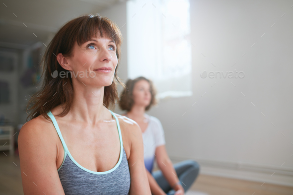 Yoga trainer during workout session in gym - Stock Photo - Images