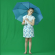 Little Girl Stands with Umbrella & Smiling - VideoHive Item for Sale
