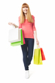 Young, happy woman with shopping bags on white background