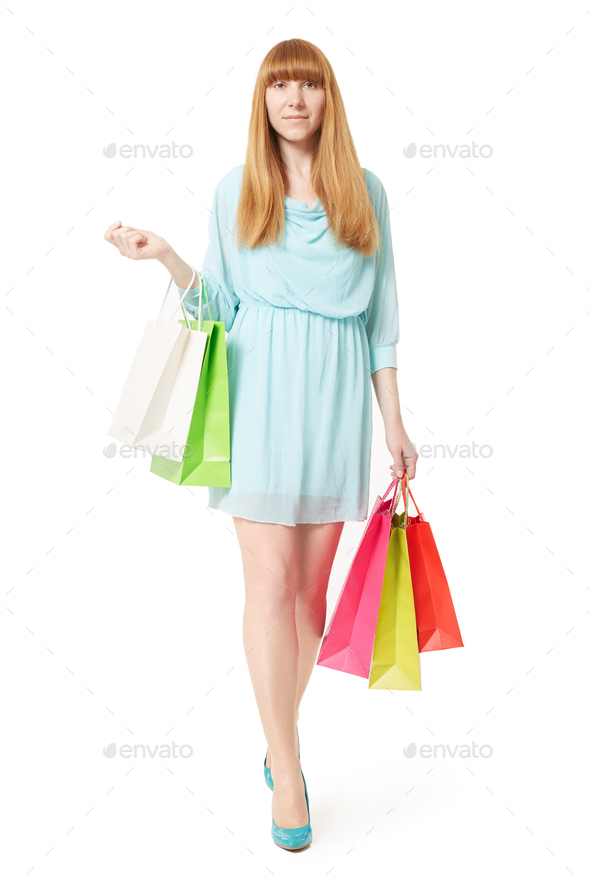 Young woman with shopping bags on white background