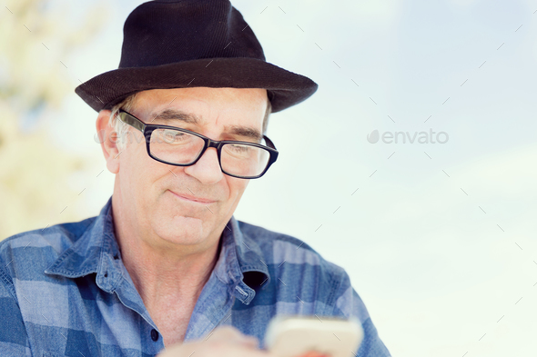 Old man with his mobile - Stock Photo - Images