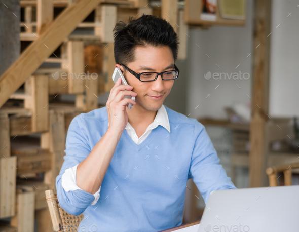 Portrait of young businessman with mobile - Stock Photo - Images