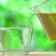 Steaming Cup Of Tea And Teapot On Blur Background - VideoHive Item for Sale