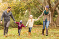 Smiling young family holding hands on an autumns day - PhotoDune Item for Sale